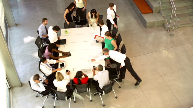 Businesspeople Leaving At The End Of Meeting Around Table video