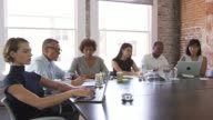 Businesspeople Listen To Boardroom Presentation Shot On R3D video