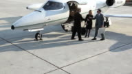 Businesspeople shaking hands by jet video