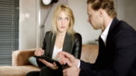 Businesspeople sit and have informal meeting. video