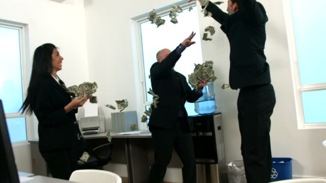 Businesspeople throwing money, slow motion video