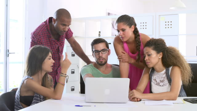 Businesspeople Using Laptop In Office Of Start Up Business video