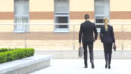 businesspeople walking on the street of an business center video