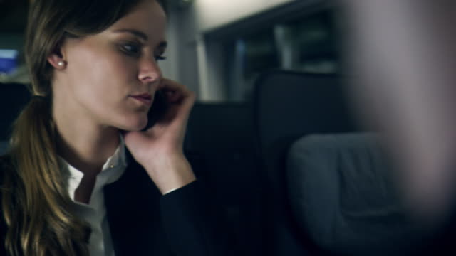 Businesspeople working in train video