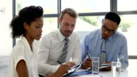 Businesspeople working together around a table video