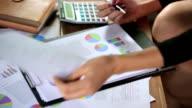 Businesswoman analysis graph video