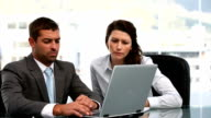 Businesswoman and a businessman working together video