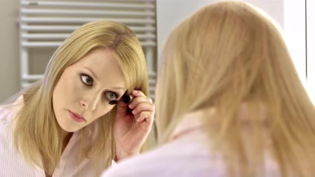 CU Businesswoman Applying Eye Mascara video