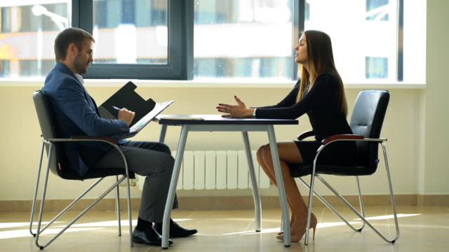 businesswoman asking questions at the interview video