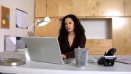 Businesswoman at desk video