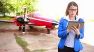 Businesswoman at plane video