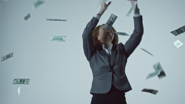 Businesswoman Catching Falling Money video