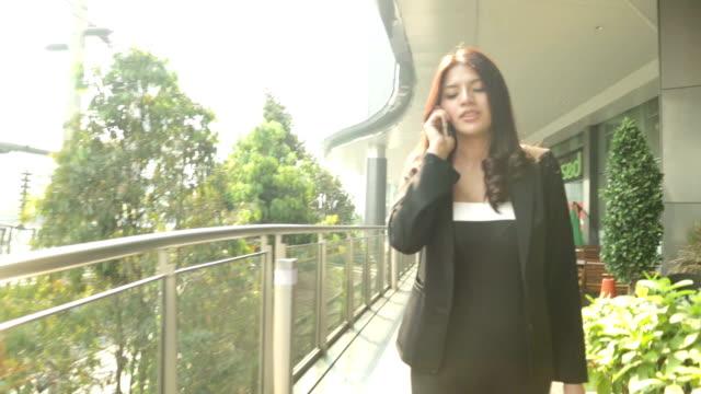 Businesswoman Confidence walking on skywalk to work video