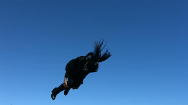 Businesswoman does a flip, slow motion video