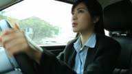 Businesswoman driving a car video