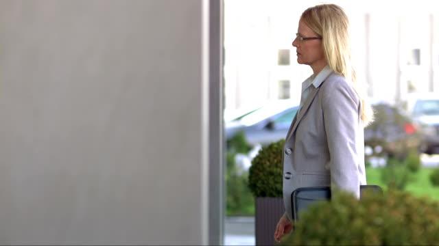 DS TU Businesswoman Entering The Office Building video
