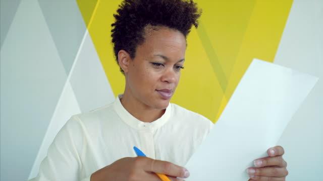 Businesswoman examining documents. video