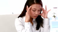 Businesswoman feeling stressed at her desk video