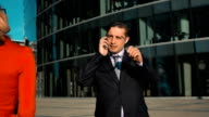 Businesswoman flirting with employee video