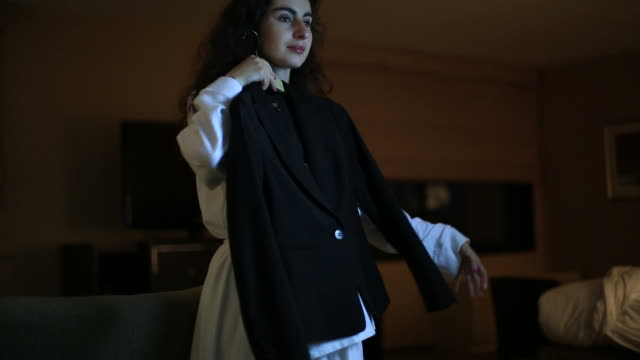 Businesswoman getting ready in a hotel room video