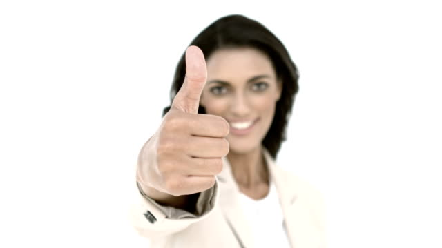 Businesswoman giving the thumbs up video