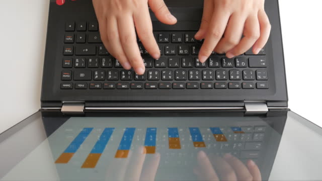 Businesswoman Hands typing on laptop keyboard for checking digital graph video