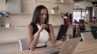 Businesswoman has conference call with partner on the touch screen tablet video
