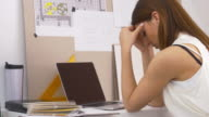 Businesswoman having a headache in home office video