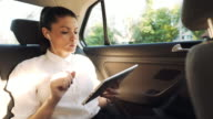 Businesswoman having a video call in the car. video