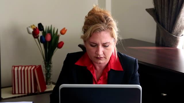 Businesswoman having neck pain video