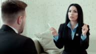 Businesswoman in a uniform talks video