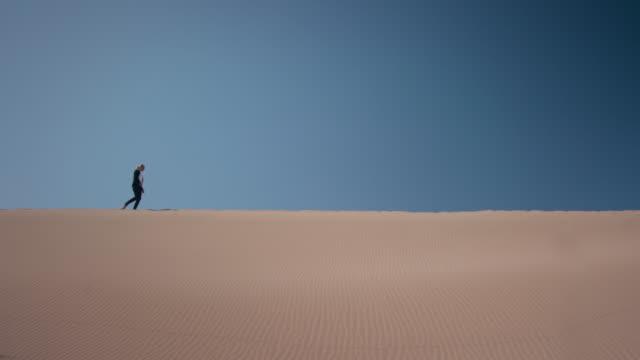 Businesswoman in desert video