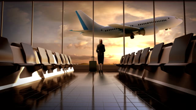 Businesswoman in flight waiting hall. Departure airplane in sunset. video