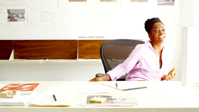 Businesswoman in office video