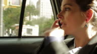 Businesswoman in taxi video