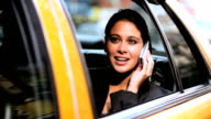 Businesswoman in Taxi with Cell Phone video