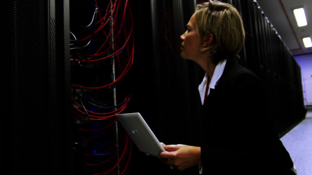 IT businesswoman inspects data center servers video