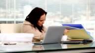 Businesswoman looking for a folder video