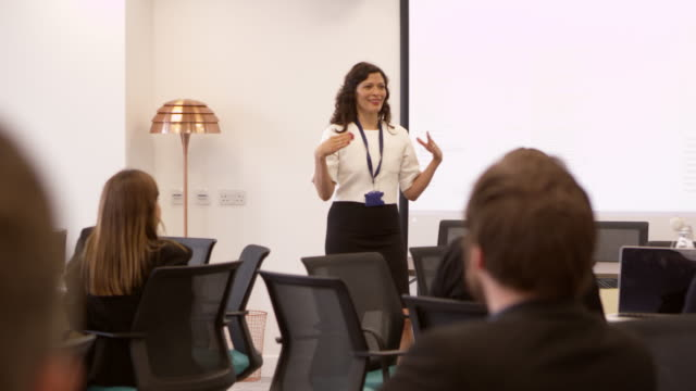 Businesswoman Making Presentation At Conference Shot On R3D video