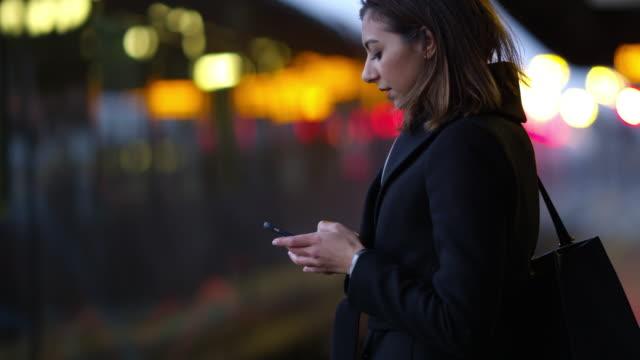 Businesswoman On Platform Waiting For Train Shot On R3D video