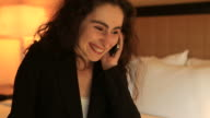Businesswoman on the phone (inside hotel room) video