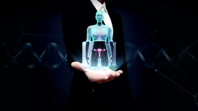 Businesswoman open palm, Zooming female body scanning womb, X-ray image. video