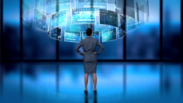 Businesswoman processing revolving interface video