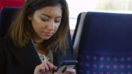 Businesswoman Reading Text Message On Train Shot On R3D video