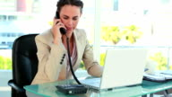 Businesswoman receiving a good news by phone video