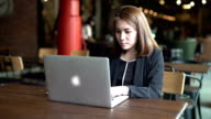 Businesswoman sitting and working in cafe video