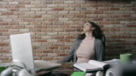 Businesswoman sleeping at the office video
