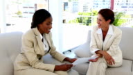 Businesswoman smiling and shaking hands video