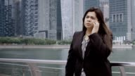 Businesswoman Standing Outdoors, Talking on Phone video