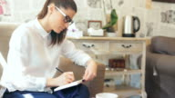 Businesswoman taking notes. video